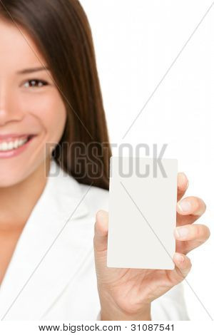 Woman showing business card. Businesswoman in suit holding blank card sign. Can be replaced with mobile phone or smart phone. Mixed race Asian / Caucasian business woman on white background in suit.