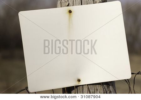 Blank White Sign On Fence Post