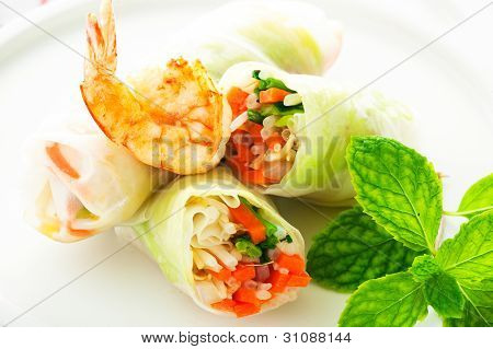 Vegetarian Spring Roll With Carrot, Soy Sprouts And Shrimp On White Background As A Studio Shot