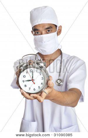 Surgeon With An Alarm Clock