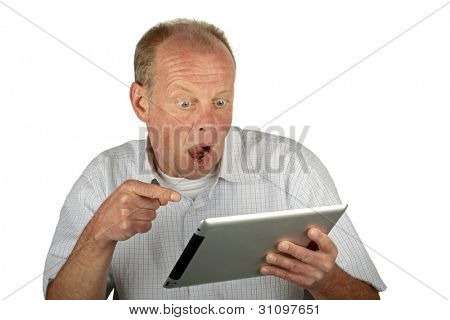 Astonished man looking at his tablet computer