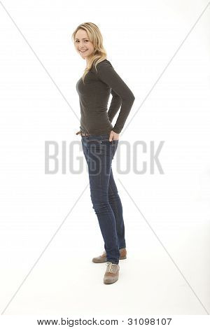 Woman Standing With Hands On Her Back Pocket