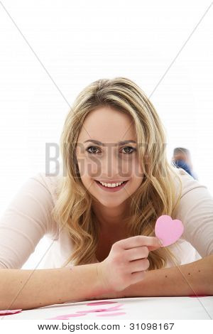 Blonde Woman Holding A Pink Heart