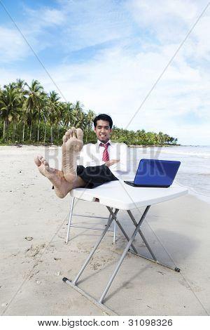 Businessman Relaxing At Beach