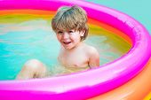 Children Play In Tropical Resort. Child Boy And Best Swimming Pool. Cute Kid Relaxing On Swimming Po poster