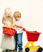 Girl And Boy Children Shopping. Kids Store. Couple Kids Hold Plastic Shopping Basket Toy. Buy With D poster