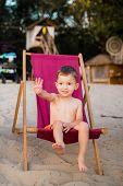 Beach Boy. Little Beach Baby Sitting On Beach Chair. Boy Sitting On The Chair By Sea. Little Boy Sit poster