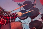 Rock, Music And Hobby Concept - Drummers Foot Wears Sneakers Pushing Drum Bass Pedal poster