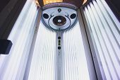 Vertical Tanning Turbo Solarium Light Machine With Glowing Blue Light Ultraviolet Lamps For Tanning  poster