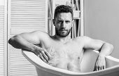 Man Muscular Torso Sit In Bathtub. Skin Care. Hygienic Procedure Concept. Total Relaxation. Personal poster