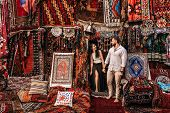 Man And Woman In The Store. Couple In Love In Turkey. Man And Woman In The Eastern Country. Happy Co poster