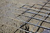 pic of concrete pouring  - Rebar grids in a concrete floor during a pour - JPG