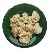 Dumplings On A Green  Plate Isolated On White Background .boiled Dumplings.meat Dumplings Top View . poster