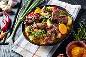 Traditional Jamaican Curry Goat - Slow Cooked Jamaican Spiced Meat And Vegetables Spicy Curry In A B poster