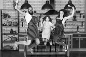 Cooking With Child Might Be Fun. Having Fun In Kitchen. Family Mom Dad And Little Daughter Wear Apro poster