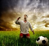 a soccer player on the grass field