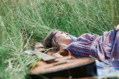 Close Up.young Hippie Woman Resting Lying On The Grass poster