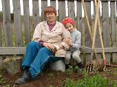 foto of household farm  - little girl with grandmother at the rural farm - JPG