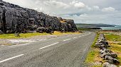 Irish Landscape Along ​​the Burren With The Rural Coastal R477 Road And The Sea In The Background, G poster