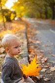 Warmth And Coziness. Happy Childhood. Sweet Childhood Memories. Child Autumn Leaves Background. Warm poster