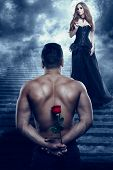 Romantic Couple, Man Give Flower To Beautiful Woman, Sexy Lover Athletic Holding Rose And Looking To poster