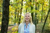 Autumn Beauty. Sweet Young Sensual Sexy Woman Walking In Autumn Park. Autumnal Mood. Cheerful Carefr poster