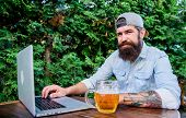 Laptop Continues To Assist Virtual Employees. Laptop User Drinking Beer In Outdoor Cafe. Bearded Man poster