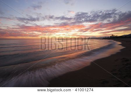 Beach at sunset, Puerto Cabopino, Marbella, Spain.