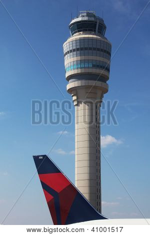 Delta plane next to Air Traffic Control Tower at Atlanta airport