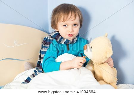 Little Sick Baby Boy Checking Teddy Bear's Body Temperature
