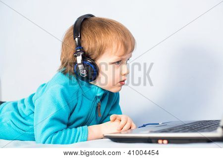 Little Kid Watching A Movie On Laptop Computer