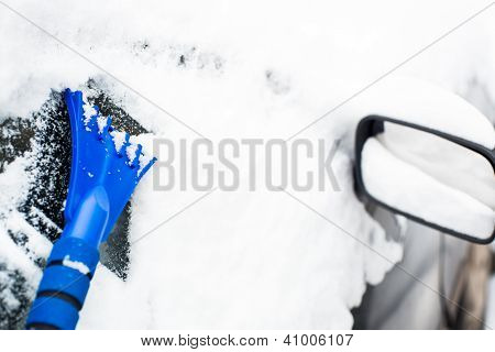 Cleaning The Glass With Ice Scraper