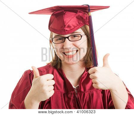 Young female college or high school graduate giving the thumbs up sign.  Isolated on white.