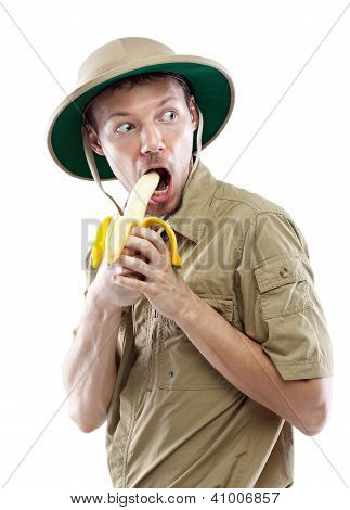 Explorer In Pith Helmet Eating Banana