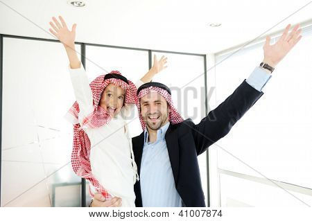 Arabic Muslim business people with children at office