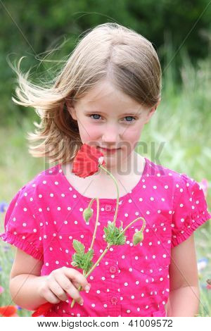 Little girl with poppy flowers