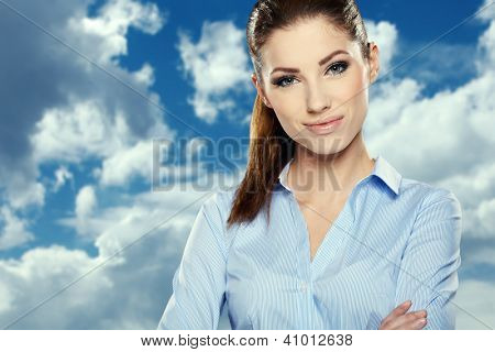 Portrait of smiling business woman, isolated on sky background