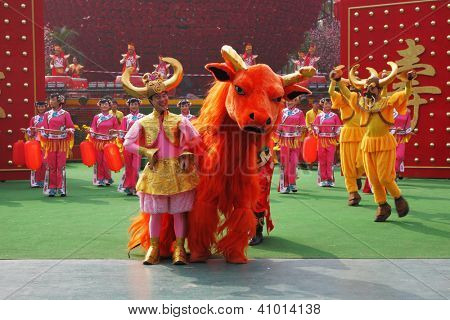 SHENZHEN, CHINA-JANUARY 22: Dance ensemble in the original unusual costumes on January,22,2009 in Folk Culture Villages, Shenzhen, China. Chinese New Year Parade.