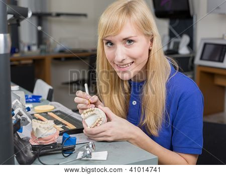 Dental Lab Technician Applying Porcelain To Dentition Mold