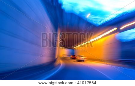 Car moving into tunnel