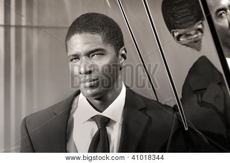 Portrait of a cool young businessman in modern setting in suit and tie