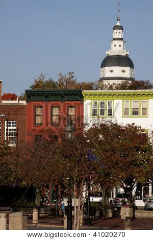 Colorful buildings in the downtown area of Annapolis with the Maryland State House in the background.