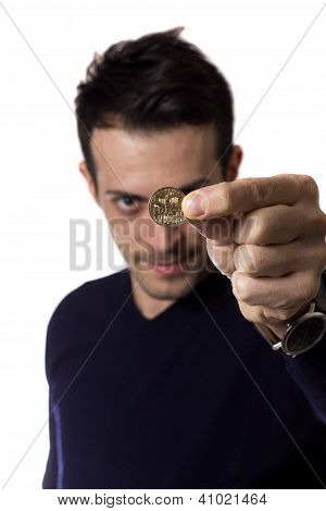 Young Man Showing A Coin