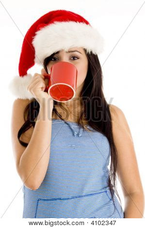 Girl With Christmas Hat And Taking Coffee