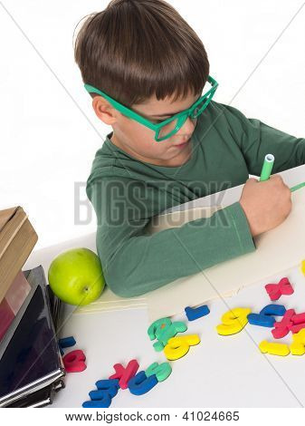 young boy writing his homework