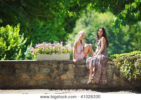 Two women over park background