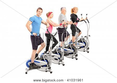 A group of people working on a cross trainer machine isolated against white background