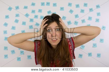Young woman with nose ring with blue sticky notes with yes no thinking about decision making