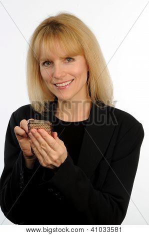 Attractive blond business woman texting on cellular phone