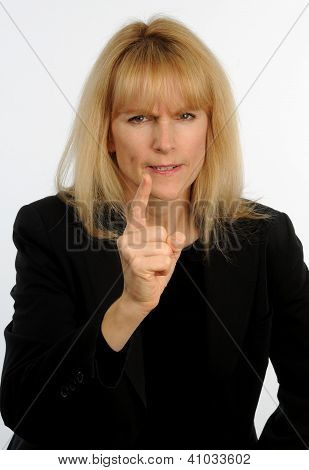 Attractive blond haired business woman wags finder in anger